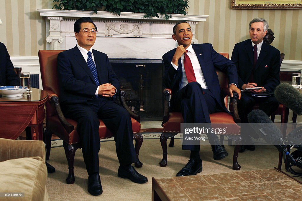 U.S. President <a gi-track='captionPersonalityLinkClicked' href=/galleries/search?phrase=Barack+Obama&family=editorial&specificpeople=203260 ng-click='$event.stopPropagation()'>Barack Obama</a> (2R) and Chinese President <a gi-track='captionPersonalityLinkClicked' href=/galleries/search?phrase=Hu+Jintao&family=editorial&specificpeople=203109 ng-click='$event.stopPropagation()'>Hu Jintao</a> (L) meet in the Oval Office with interpreters at the White House January 19, 2011 in Washington, DC. Obama and Hu are scheduled to hold a joint press conference and attend a State dinner.