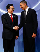 S President Barack Obama and Chinese President Hu Jintao pose for photographs at the start of the Nuclear Security Summit at the Washington...
