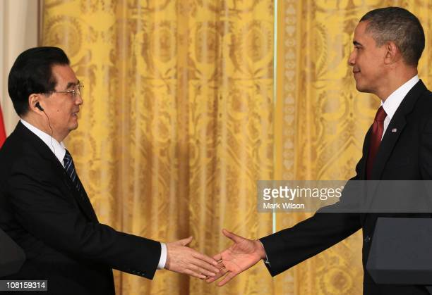S President Barack Obama and Chinese President Hu Jintao shake hands following a joint press conference in the East Room of the White House January...