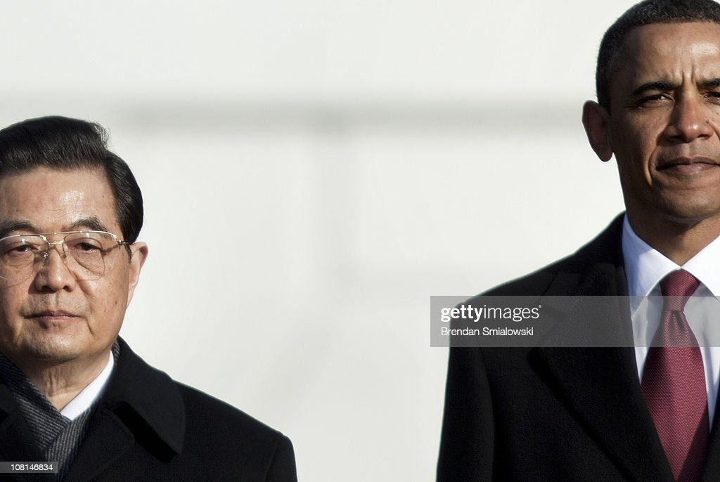 U.S. President <a gi-track='captionPersonalityLinkClicked' href=/galleries/search?phrase=Barack+Obama&family=editorial&specificpeople=203260 ng-click='$event.stopPropagation()'>Barack Obama</a> (R) and Chinese President <a gi-track='captionPersonalityLinkClicked' href=/galleries/search?phrase=Hu+Jintao&family=editorial&specificpeople=203109 ng-click='$event.stopPropagation()'>Hu Jintao</a> stand together at the conclusion of a state arrival ceremony on the South Lawn of the White House January 19, 2011 in Washington, DC. Obama and Hu are schedule to meet in the Oval Office later in the day, hold a joint press conference and attend a State dinner.
