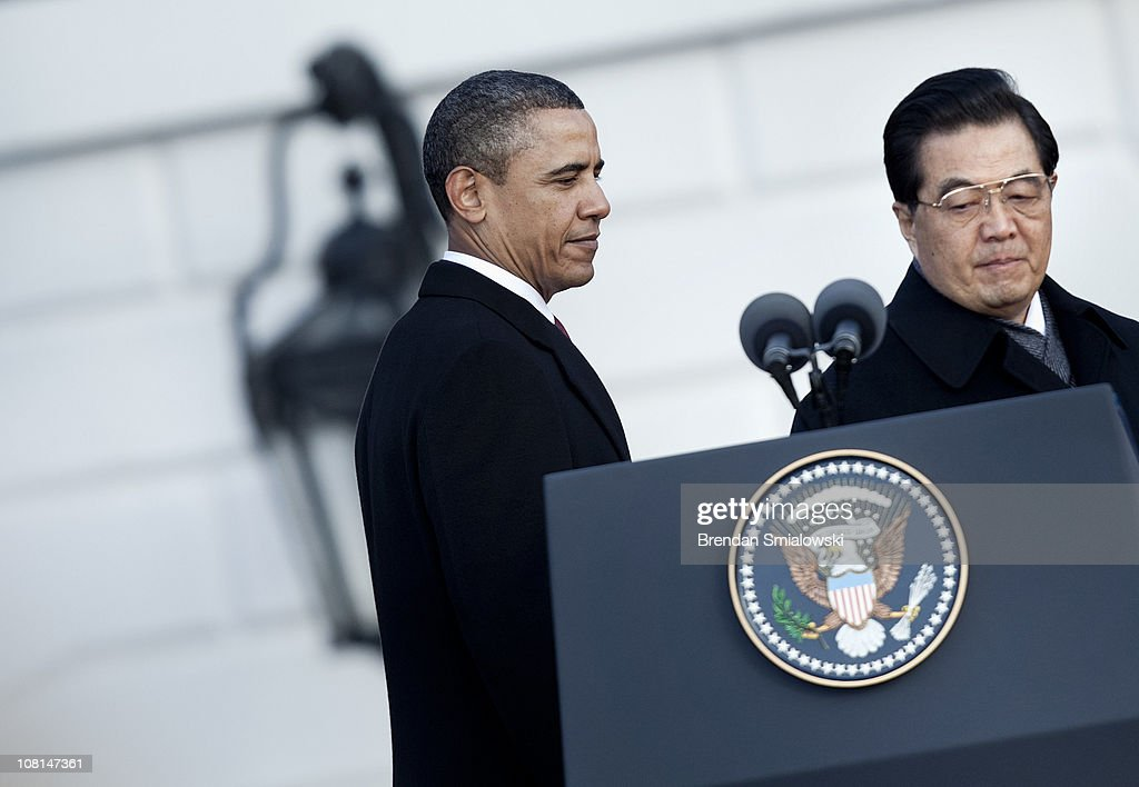 U.S. President Barack Obama (L) and Chinese President Hu Jintao walk to a lectern to make statements during a state arrival ceremony on the South Lawn of the White House January 19, 2011 in Washington, DC. Obama and Hu are schedule to meet in the Oval Office later in the day, hold a joint press conference and attend a State dinner.
