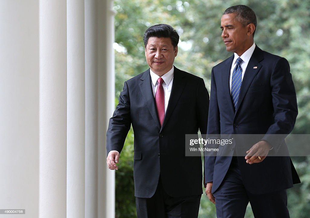 U.S. President Barack Obama (R) and Chinese President Xi Jinping (L) arrive for a joint press conference in the Rose Garden at The White House on September 25, 2015 in Washington, DC. Jinping is in the U.S. on an official state visit to meet with President Obama to discuss a range of issues.