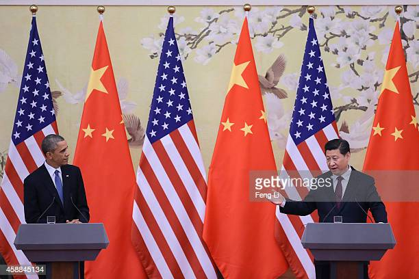 S President Barack Obama and Chinese President Xi Jinping attend a press conference at the Great Hall of People on November 12 2014 in Beijing China...