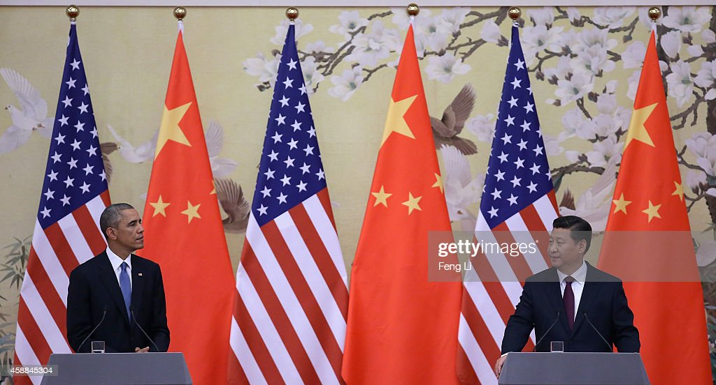 U.S. President <a gi-track='captionPersonalityLinkClicked' href=/galleries/search?phrase=Barack+Obama&family=editorial&specificpeople=203260 ng-click='$event.stopPropagation()'>Barack Obama</a> (L) and Chinese President <a gi-track='captionPersonalityLinkClicked' href=/galleries/search?phrase=Xi+Jinping&family=editorial&specificpeople=2598986 ng-click='$event.stopPropagation()'>Xi Jinping</a> (R) attend a press conference at the Great Hall of People on November 12, 2014 in Beijing, China. U.S. President <a gi-track='captionPersonalityLinkClicked' href=/galleries/search?phrase=Barack+Obama&family=editorial&specificpeople=203260 ng-click='$event.stopPropagation()'>Barack Obama</a> pays a state visit to China after attending the 22nd Asia-Pacific Economic Cooperation (APEC) Economic Leaders' Meeting.