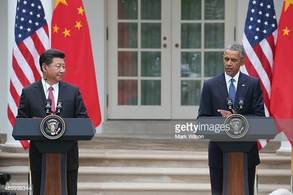 S President Barack Obama and Chinese President Xi Jinping attend a joint press conference in the Rose Garden at The White House on September 25 2015...