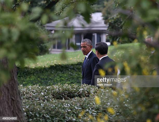 S President Barack Obama and Chinese President Xi Jinping leave a joint news conference in the Rose Garden at The White House on September 25 2015 in...