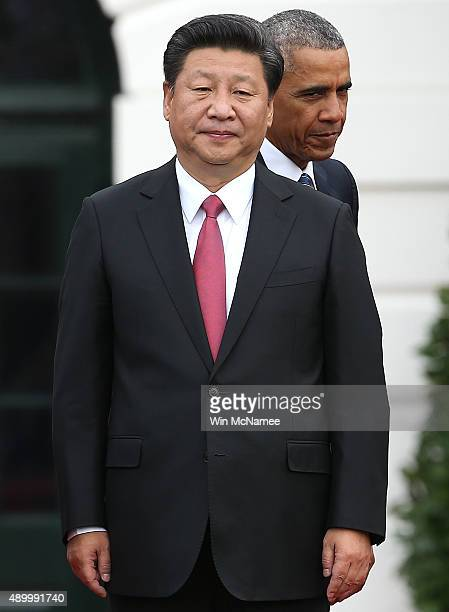 S President Barack Obama and Chinese President Xi Jinping participate in a state arrival ceremony on the south lawn of the White House grounds...