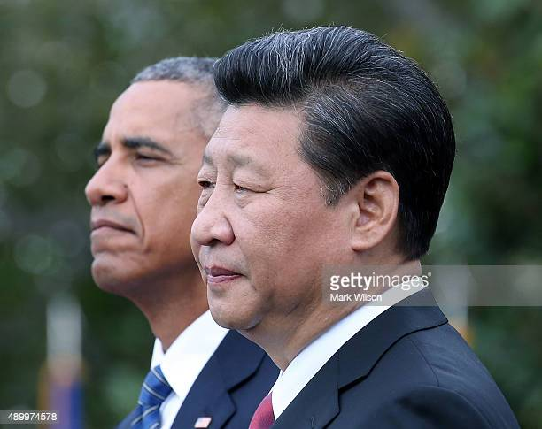 President Barack Obama and Chinese president Xi Jinping stand together during arrival ceremony at the White House September 25 2015 in Washington DC...