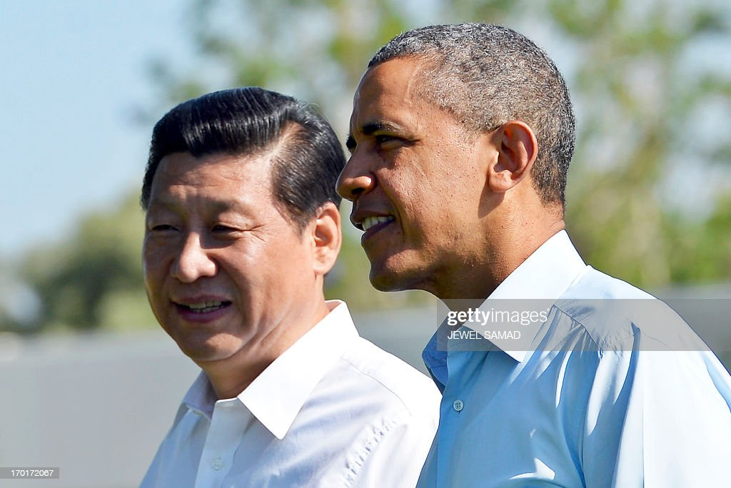US President Barack Obama (R) and Chinese President Xi Jinping take a walk at the Annenberg Retreat at Sunnylands in Rancho Mirage, California, on June 8, 2013. Obama and Xi wrap up their debut summit Saturday, grasping for a personal understanding that could ease often prickly US-China relations. Skipping the usual summit pageantry, Obama and Xi went without neckties, in a departure from the stifling formality that marked Obama's halting interactions with China's ex-president Hu Jintao. AFP PHOTO/Jewel Samad /