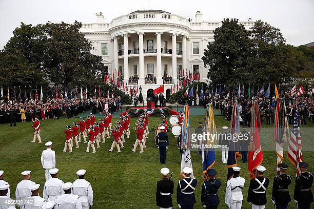 S President Barack Obama and Chinese President Xi Jinping watch a fife and drum corps performance during a state arrival ceremony on the south lawn...
