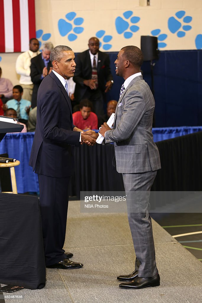 President Barack Obama and Chris Paul #3 of the Los Angeles Clippers greet each other during the My Brother's Keeper Initiative on July 21, 2014 at the Walker Jones Education Campus in Washington DC.