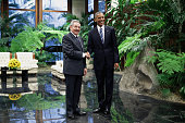 S President Barack Obama and Cuban President Raul Castro greet one another before bilateral meetings at the Palace of the Revolution March 21 2016 in...