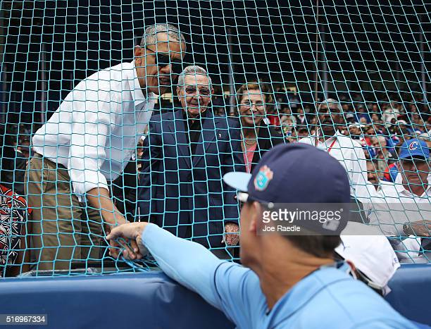 S President Barack Obama and Cuban President Raul Castro greet players from the Tampa Bay Rays before an exhibition game between the Cuban national...