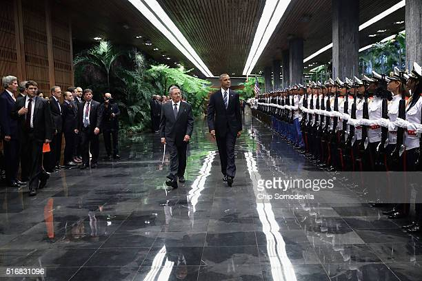 S President Barack Obama and Cuban President Raul Castro review troops before bilateral meetings at the Palace of the Revolution March 21 2016 in...