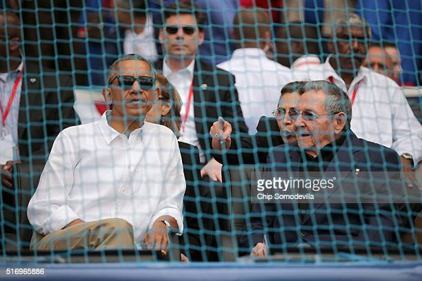 S President Barack Obama and Cuban President Raul Castro talk before the start of an exhibition game between the Cuban national team and the Major...