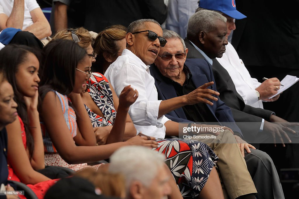 S President Barack Obama and Cuban President Raul Castro visit during an exhibition game between the Cuban national team and the Major League...