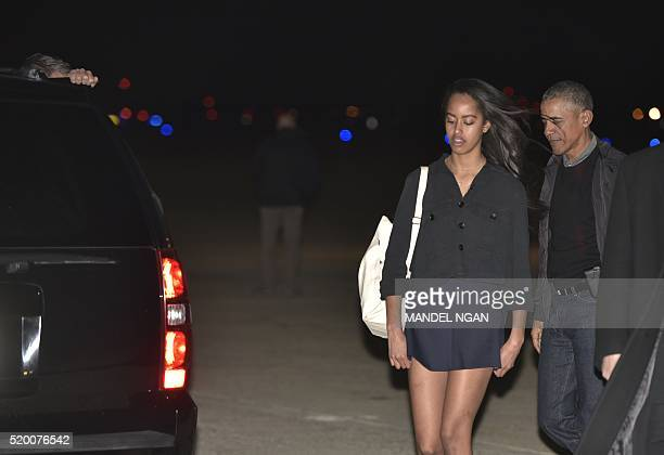 US President Barack Obama and daughter Malia make their way to a SUV upon arrival at at Andrews Air Force Base in Maryland on April 9 2016 / AFP /...
