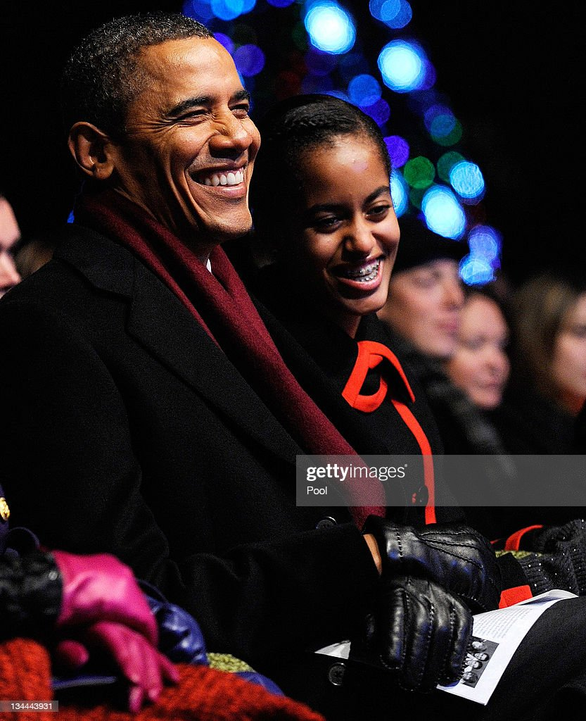 U.S. President <a gi-track='captionPersonalityLinkClicked' href=/galleries/search?phrase=Barack+Obama&family=editorial&specificpeople=203260 ng-click='$event.stopPropagation()'>Barack Obama</a> and daughter Malia (R) participate in the 2011 National Christmas Tree Lighting on December 1, 2011 at the Ellipse, south of the White House, in Washington, DC. The first family participated in the 89th annual National Christmas Tree Lighting Ceremony.