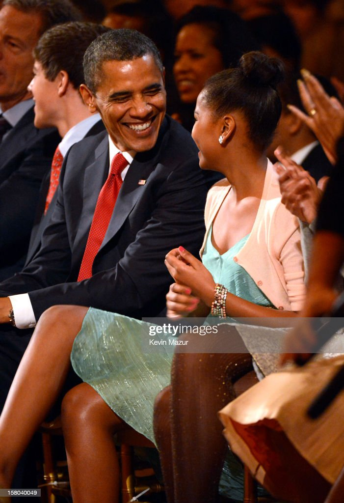 U.S. President <a gi-track='captionPersonalityLinkClicked' href=/galleries/search?phrase=Barack+Obama&family=editorial&specificpeople=203260 ng-click='$event.stopPropagation()'>Barack Obama</a> and daughter <a gi-track='captionPersonalityLinkClicked' href=/galleries/search?phrase=Sasha+Obama&family=editorial&specificpeople=2631619 ng-click='$event.stopPropagation()'>Sasha Obama</a> attend TNT Christmas in Washington 2012 at National Building Museum on December 9, 2012 in Washington, DC. 23098_003_KM_1110.JPG