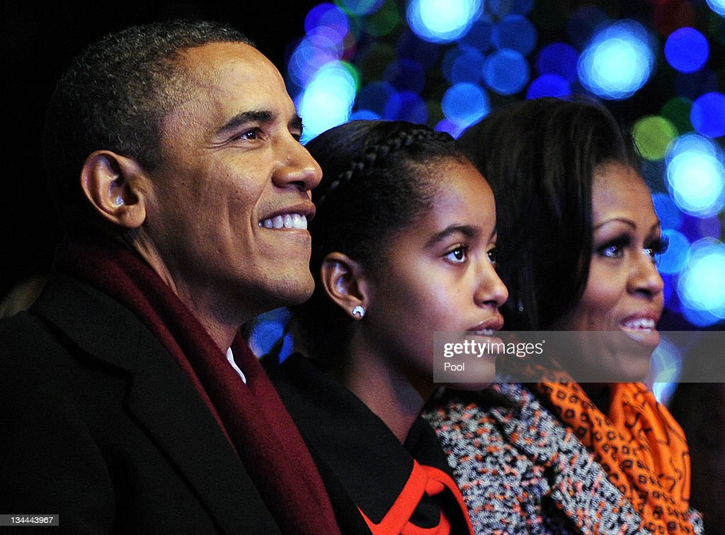 U.S. President <a gi-track='captionPersonalityLinkClicked' href=/galleries/search?phrase=Barack+Obama&family=editorial&specificpeople=203260 ng-click='$event.stopPropagation()'>Barack Obama</a> (L) and daughters Malia (C) and first lady <a gi-track='captionPersonalityLinkClicked' href=/galleries/search?phrase=Michelle+Obama&family=editorial&specificpeople=2528864 ng-click='$event.stopPropagation()'>Michelle Obama</a> (R) participate in the 2011 National Christmas Tree Lighting on December 1, 2011 at the Ellipse, south of the White House, in Washington, DC. The first family participated in the 89th annual National Christmas Tree Lighting Ceremony.