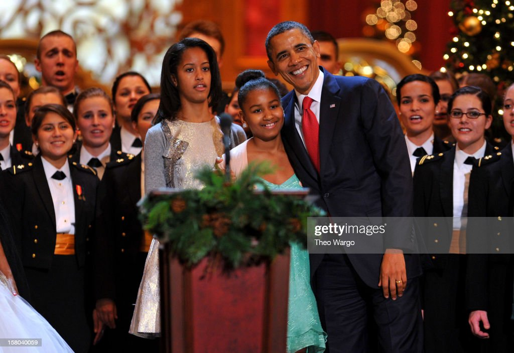 U.S. President <a gi-track='captionPersonalityLinkClicked' href=/galleries/search?phrase=Barack+Obama&family=editorial&specificpeople=203260 ng-click='$event.stopPropagation()'>Barack Obama</a> (R) and daughters <a gi-track='captionPersonalityLinkClicked' href=/galleries/search?phrase=Malia+Obama&family=editorial&specificpeople=2631620 ng-click='$event.stopPropagation()'>Malia Obama</a> (L) and <a gi-track='captionPersonalityLinkClicked' href=/galleries/search?phrase=Sasha+Obama&family=editorial&specificpeople=2631619 ng-click='$event.stopPropagation()'>Sasha Obama</a> (C) onstage during TNT Christmas in Washington 2012 at National Building Museum on December 9, 2012 in Washington, DC. 23098_002_TW_0656.JPG