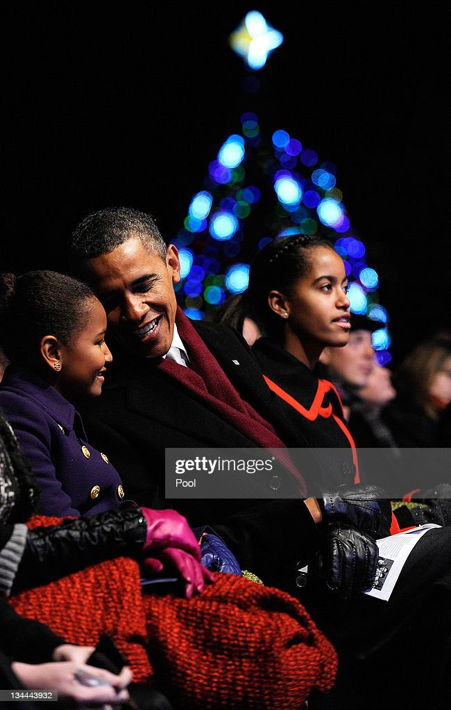 U.S. President <a gi-track='captionPersonalityLinkClicked' href=/galleries/search?phrase=Barack+Obama&family=editorial&specificpeople=203260 ng-click='$event.stopPropagation()'>Barack Obama</a> and daughters Sasha (L) and Malia participate in the 2011 National Christmas Tree Lighting on December 1, 2011 at the Ellipse, south of the White House, in Washington, DC. The first family participated in the 89th annual National Christmas Tree Lighting Ceremony.