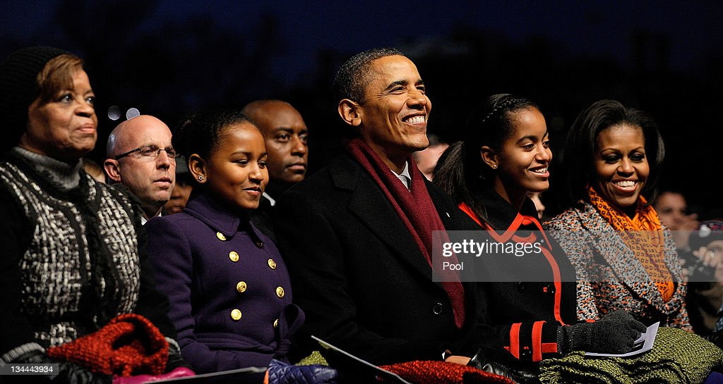 U.S. President <a gi-track='captionPersonalityLinkClicked' href=/galleries/search?phrase=Barack+Obama&family=editorial&specificpeople=203260 ng-click='$event.stopPropagation()'>Barack Obama</a> (C) and daughters Sasha (2nd L), Malia (2nd R) along with <a gi-track='captionPersonalityLinkClicked' href=/galleries/search?phrase=Marian+Robinson&family=editorial&specificpeople=5505642 ng-click='$event.stopPropagation()'>Marian Robinson</a> (L) and first lady <a gi-track='captionPersonalityLinkClicked' href=/galleries/search?phrase=Michelle+Obama&family=editorial&specificpeople=2528864 ng-click='$event.stopPropagation()'>Michelle Obama</a> (R) participate in the 2011 National Christmas Tree Lighting on December 1, 2011 at the Ellipse, south of the White House, in Washington, DC. The first family participated in the 89th annual National Christmas Tree Lighting Ceremony.