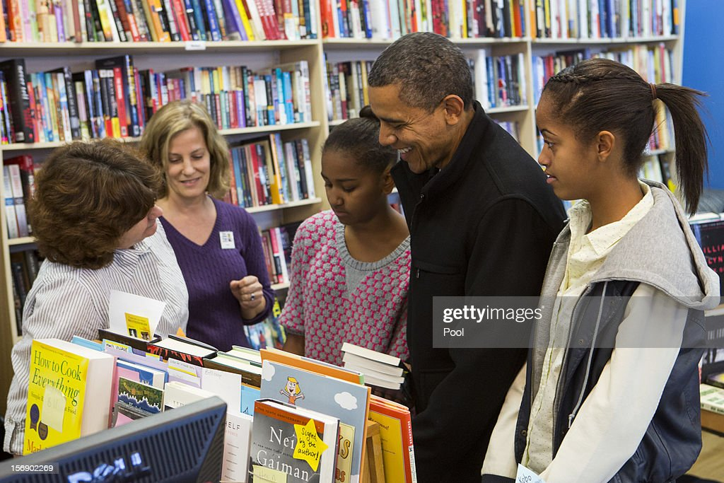 U.S. President <a gi-track='captionPersonalityLinkClicked' href=/galleries/search?phrase=Barack+Obama&family=editorial&specificpeople=203260 ng-click='$event.stopPropagation()'>Barack Obama</a> (2R) and daughters <a gi-track='captionPersonalityLinkClicked' href=/galleries/search?phrase=Sasha+Obama&family=editorial&specificpeople=2631619 ng-click='$event.stopPropagation()'>Sasha Obama</a> (C) and <a gi-track='captionPersonalityLinkClicked' href=/galleries/search?phrase=Malia+Obama&family=editorial&specificpeople=2631620 ng-click='$event.stopPropagation()'>Malia Obama</a> (R) shop at One More Page Books on Small Business Saturday November 24, 2012 in Arlington, Virginia. Obama urged Americans to participate in Small Business Saturday as an alternative to Black Friday and Cyber Monday.