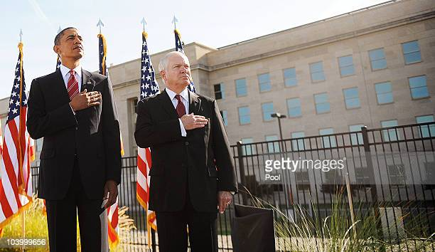 President Barack Obama and Defense Secretary Robert Gates listen to the National Anthem during an event marking the anniversary of the 9/11 terrorist...