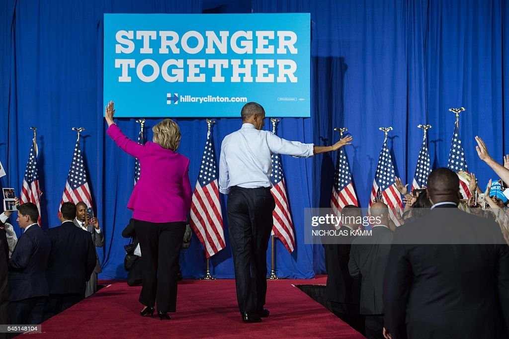 President Barack Obama and Democratic presidential candidate Hillary Clinton leave a campaign event in Charlotte, North Carolina, on July 5, 2016. US President Barack Obama threw his full weight behind Hillary Clinton's bid to succeed him, extolling the experience and fighting spirit of his former secretary of state at their first joint campaign appearance. 'I'm here today because I believe in Hillary Clinton,' Obama told the rally in Charlotte, North Carolina. 'There has never been any man or woman more qualified for this office.' / AFP / NICHOLAS