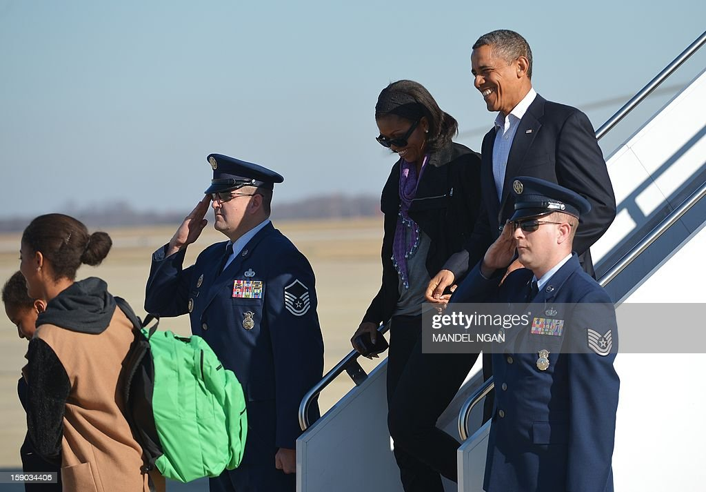 US President Barack Obama and First Lady Michelle Obama along with daughters Malia and Sasha step off Air Force One on January 6, 2013 upon arrival at Andrews Air Force Base in Maryland. Obama returned to Washington after finishing his vacation in Hawaii. AFP PHOTO/Mandel NGAN
