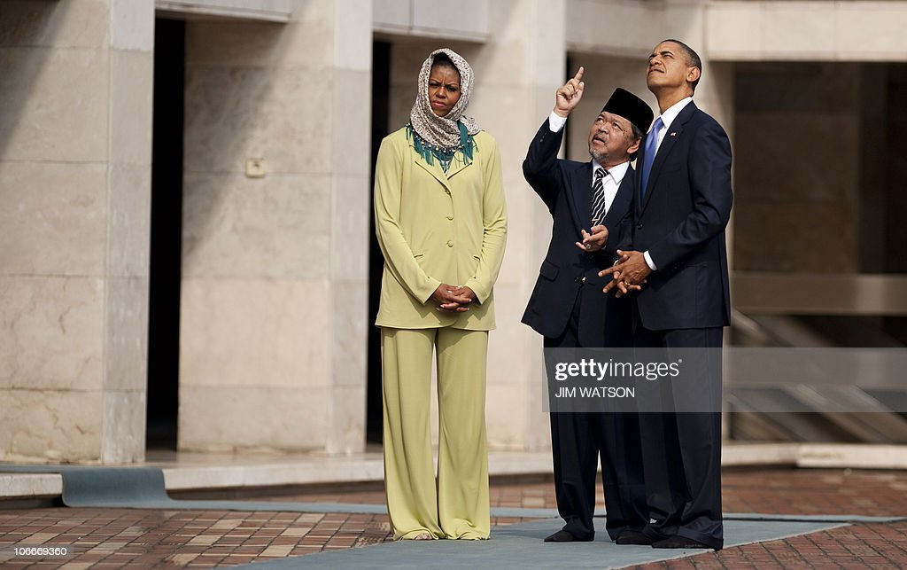 US President Barack Obama and First Lady Michelle Obama are led on a tour by Grand Imam Yaqub at the Istiqlal Mosque in Jakarta on November 10 2010...
