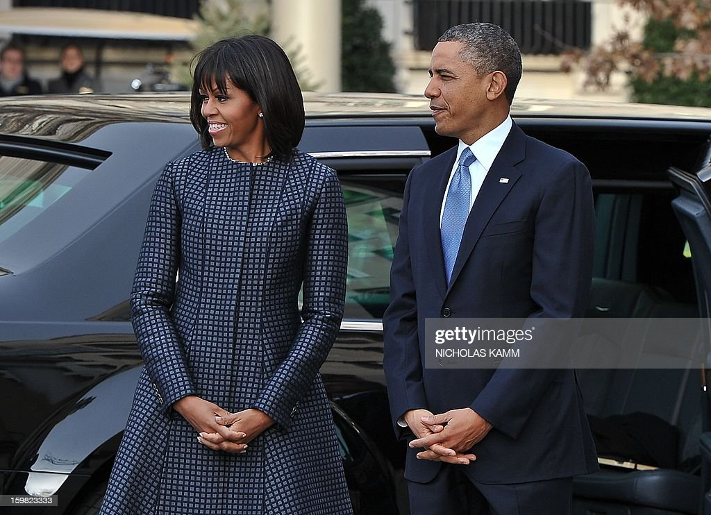 US President Barack Obama and First Lady Michelle Obama arrive at St. John's Church on January 21, 2013 in Washington, DC, hours before Obama participates in a ceremonial swearing in for a second term in office. AFP PHOTO/Nicholas KAMM