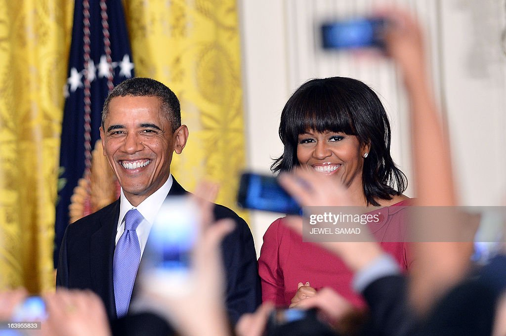 US President <a gi-track='captionPersonalityLinkClicked' href=/galleries/search?phrase=Barack+Obama&family=editorial&specificpeople=203260 ng-click='$event.stopPropagation()'>Barack Obama</a> and First Lady Michelle Obama arrive at the Women's History Month Reception in the East Room of the White House in Washington on March 18, 2013. AFP PHOTO/Jewel Samad