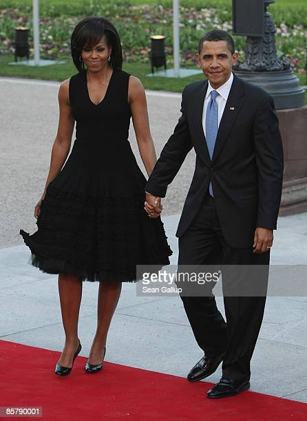 S President Barack Obama and First Lady Michelle Obama arrive at the opening of the NATO summit at the Kurhaus on April 3 2009 in Baden Baden Germany...