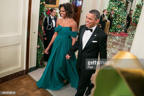 President Barack Obama and First Lady Michelle Obama arrive for a reception at the White House for the 2013 Kennedy Center Honorees on December 8...