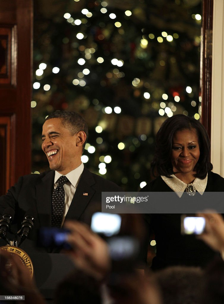 U.S. President <a gi-track='captionPersonalityLinkClicked' href=/galleries/search?phrase=Barack+Obama&family=editorial&specificpeople=203260 ng-click='$event.stopPropagation()'>Barack Obama</a> and first lady <a gi-track='captionPersonalityLinkClicked' href=/galleries/search?phrase=Michelle+Obama&family=editorial&specificpeople=2528864 ng-click='$event.stopPropagation()'>Michelle Obama</a> arrive for a Hanukkah reception in the Grand Foyer of the White House December 13, 2012 in Washington DC. The celebration included the lighting of candles in a 90-year-old menorah from a temple in Long Island, New York that was heavily flooded during Superstorm Sandy.