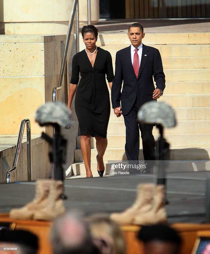 S President Barack Obama and first lady Michelle Obama arrive for a memorial service for the thirteen victims of the shooting rampage by US Army...
