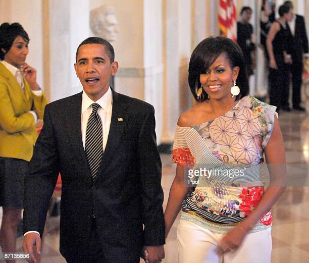 S President Barack Obama and first lady Michelle Obama arrive for An Evening of Poetry Music and the Spoken Word in the East Room of the White House...