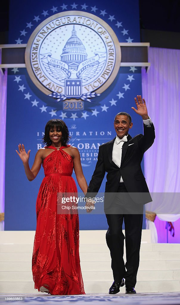 U.S. President Barack Obama and first lady Michelle Obama arrive for the Commander-In-Chief's Ball at the Walter Washington Convention Center January 21, 2013 in Washington, DC. President Obama started his second term by taking the oath of office earlier in the day during a ceremony on the West Front of the U.S. Capitol.