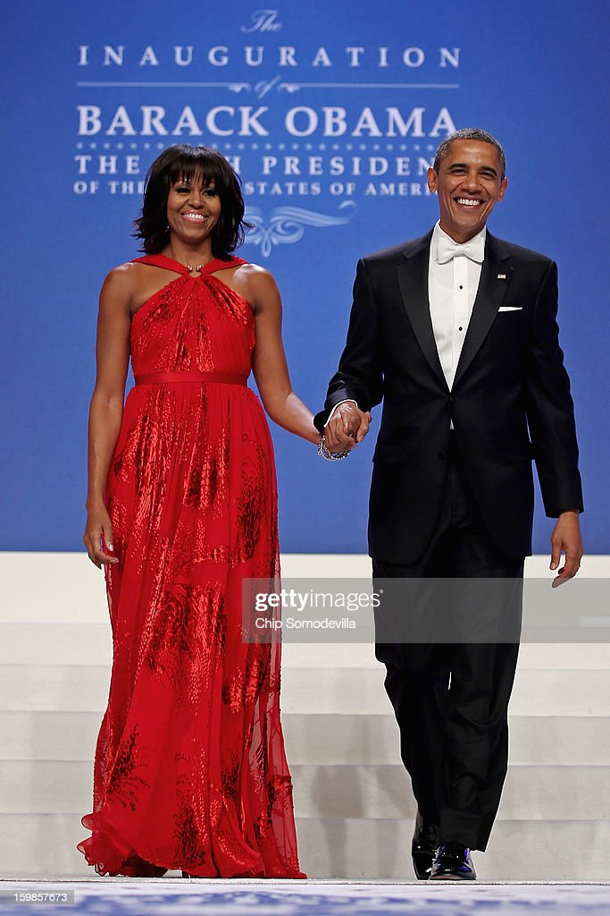 U.S. President <a gi-track='captionPersonalityLinkClicked' href=/galleries/search?phrase=Barack+Obama&family=editorial&specificpeople=203260 ng-click='$event.stopPropagation()'>Barack Obama</a> and first lady <a gi-track='captionPersonalityLinkClicked' href=/galleries/search?phrase=Michelle+Obama&family=editorial&specificpeople=2528864 ng-click='$event.stopPropagation()'>Michelle Obama</a> arrive for the Comander-in-Chief's Inaugural Ball at the Walter Washington Convention Center January 21, 2013 in Washington, DC. Obama was sworn-in for his second term of office earlier in the day.