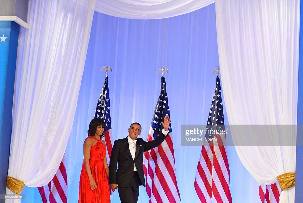 US President Barack Obama and First Lady Michelle Obama arrives on stage to attend the Inaugural Ball at the Walter E. Washington Convention Center on January 21, 2013 in Washington, DC.