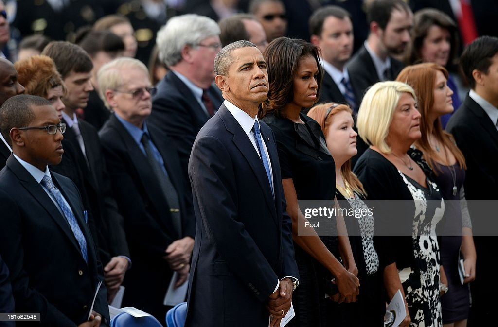 U.S. President Barack Obama and first lady Michelle Obama attend a memorial for the victims of the Washington Navy Yard shooting September 22, 2013 at the Marine Barracks in Washington, D.C. President Obama and the first lady visited with families of the victims.