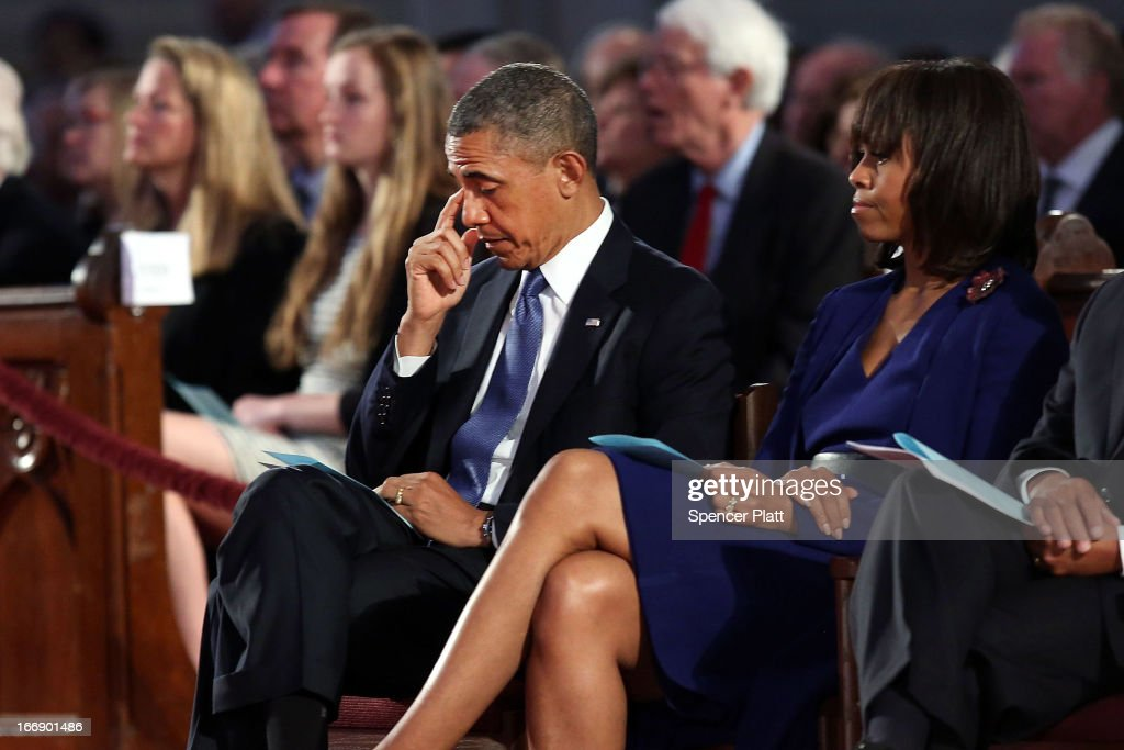 President <a gi-track='captionPersonalityLinkClicked' href=/galleries/search?phrase=Barack+Obama&family=editorial&specificpeople=203260 ng-click='$event.stopPropagation()'>Barack Obama</a> (L) and first lady <a gi-track='captionPersonalityLinkClicked' href=/galleries/search?phrase=Michelle+Obama&family=editorial&specificpeople=2528864 ng-click='$event.stopPropagation()'>Michelle Obama</a> attend an interfaith prayer service for victims of the Boston Marathon attack titled 'Healing Our City,' at the Cathedral of the Holy Cross on April 18, 2013 in Boston, Massachusetts. Authorities investigating the attack on the Boston Marathon have shifted their focus to locating the person who placed a black bag down and walked away just before the bombs went off. The twin bombings at the 116-year-old Boston race, which occurred near the marathon finish line, resulted in the deaths of three people and more than 170 others injured.