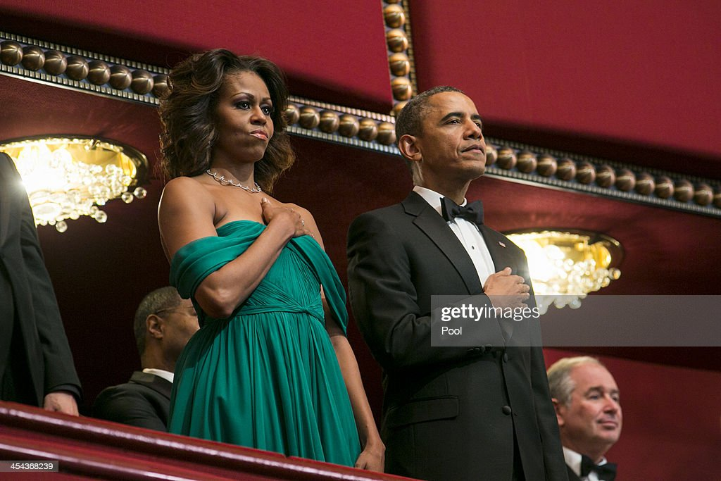 President Barack Obama and First Lady Michelle Obama attend the 2013 Kennedy Center Honors on December 8, 2013 in Washington, DC. The honorees this year include: opera singer Martina Arroyo, jazz musician Herbie Hancock, musician Billy Joel, actress Shirley MacLaine and musician Carlos Santana.