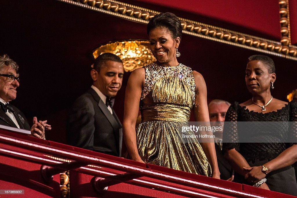 U.S. President <a gi-track='captionPersonalityLinkClicked' href=/galleries/search?phrase=Barack+Obama&family=editorial&specificpeople=203260 ng-click='$event.stopPropagation()'>Barack Obama</a> and first lady <a gi-track='captionPersonalityLinkClicked' href=/galleries/search?phrase=Michelle+Obama&family=editorial&specificpeople=2528864 ng-click='$event.stopPropagation()'>Michelle Obama</a> (C) attend the Kennedy Center Honors at the Kennedy Center on December 2, 2012 in Washington, DC. The Kennedy Center Honors recognized seven individuals - Buddy Guy, Dustin Hoffman, David Letterman, Natalia Makarova, John Paul Jones, Jimmy Page, and Robert Plant - for their lifetime contributions to American culture through the performing arts.