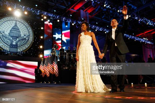 President Barack Obama and First Lady Michelle Obama attend the Neighborhood Inaugural Ball at the Washington Convention Center on January 20 2009 in...
