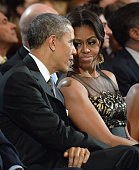 S President Barack Obama and First Lady Michelle Obama attend TNT Christmas in Washington 2014 at the National Building Museum on December 14 2014 in...