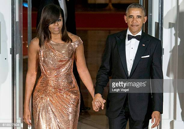 President Barack Obama and First Lady Michelle Obama await the arrival of Italian Prime Minister Matteo Renzi and Agnese Landini on October 18 2016...
