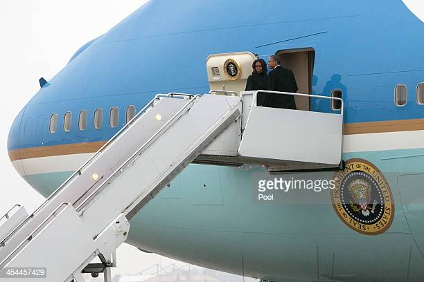 President Barack Obama and First Lady Michelle Obama board Air Force One to depart for the funeral of former South African President Nelson Mandela...